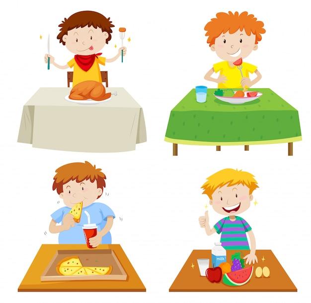 Meninos comendo na mesa de jantar