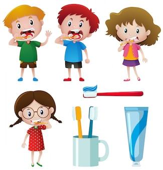 Meninos e meninas que escovam os dentes