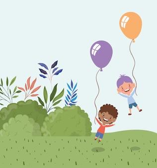 Meninos inter-raciais com balões de hélio na paisagem
