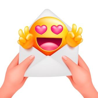 Mensagem romântica com personagem de desenho animado emoji amarelo. envelope de amor nas mãos femininas