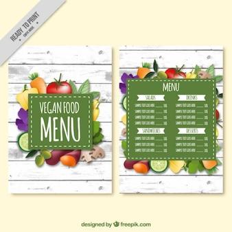Menu de comida vegan com vegetais em um fundo de madeira