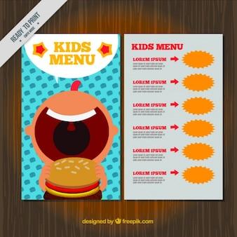 Menu infantil plana com o menino mordendo um hambúrguer