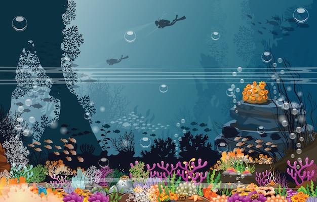 Mergulhadores e recifes no fundo do mar escuro.