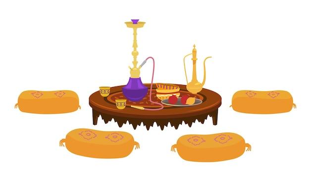 Mesa baixa redonda asiática com bule de chá e cachimbo de água com almofadas ao redor.