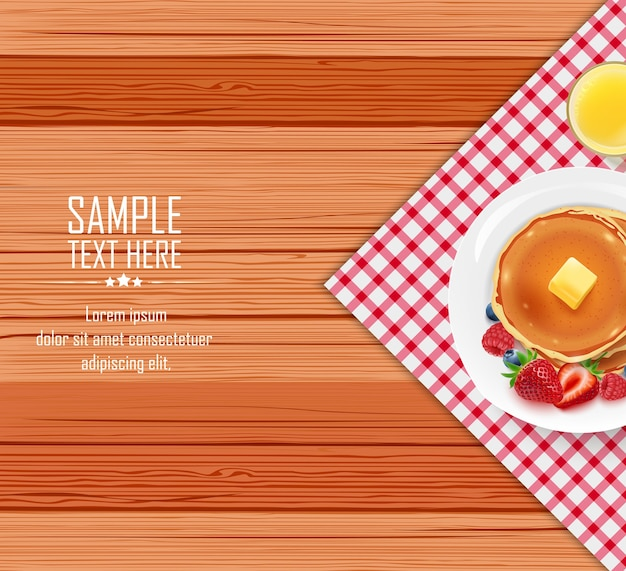 Mesa de café da manhã com panquecas e manteiga num prato