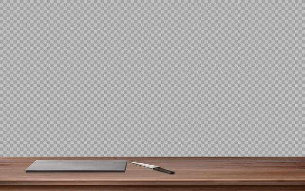 Mesa de madeira da cozinha com tábua e faca