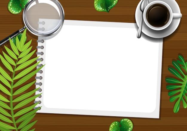 Mesa de trabalho de escritório com vista superior com elementos de escritório com folhas verdes