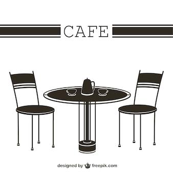 Mesa e cadeiras do café