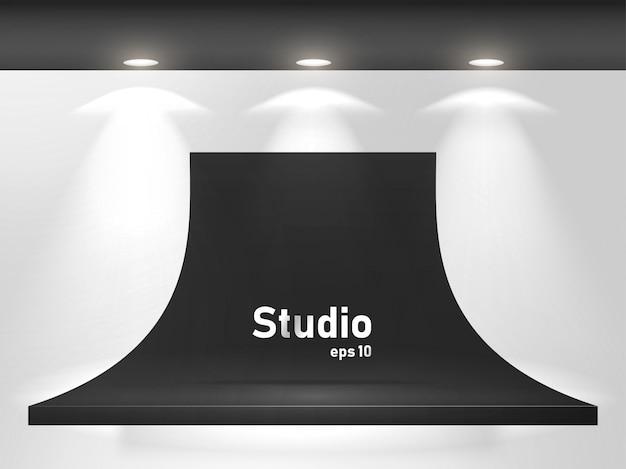 Mesa preta brilhante vazia no espaço do estúdio para exibir o design de conteúdo.