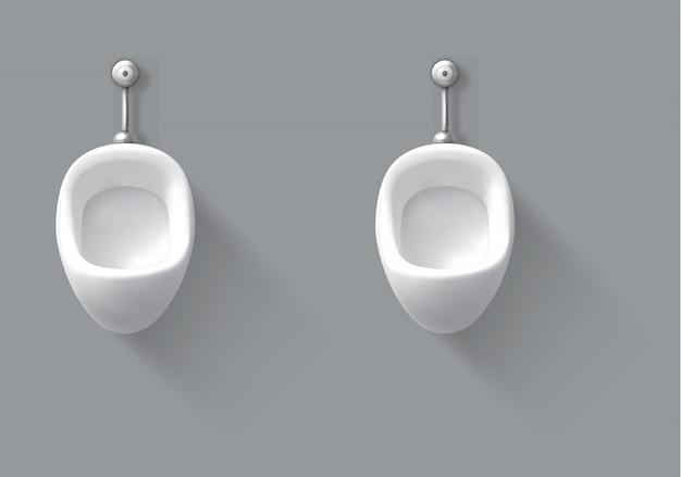 Mictório de cerâmica branco na parede no banheiro masculino