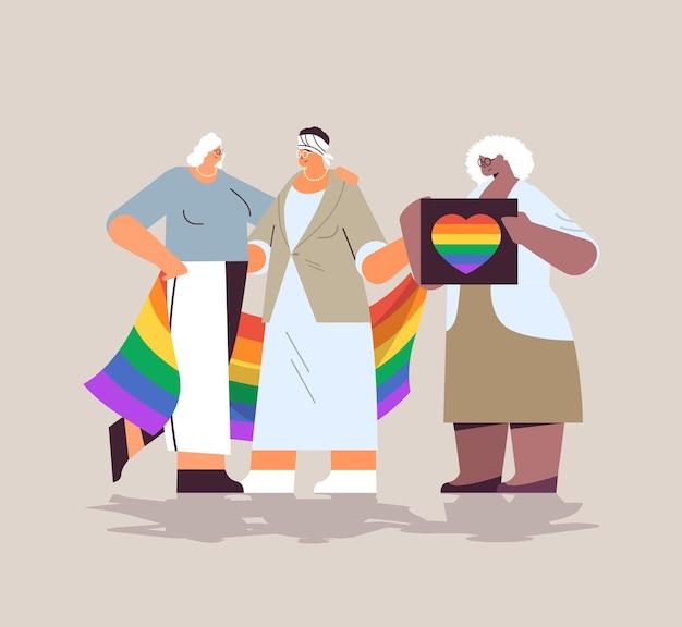 Mistura raça sênior mulheres grupo segurando lgbt arco-íris bandeira lésbica desfile do orgulho festival conceito de amor transgênero ilustração vetorial de corpo inteiro