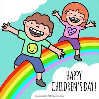 Miúdos desenhados à mão com um arco-íris