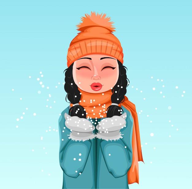 Moça com roupas de inverno brincando com neve