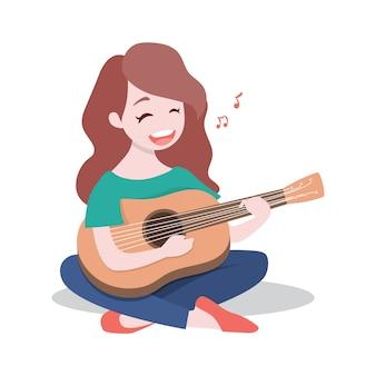 Moça feliz que joga a guitarra e canta uma música.