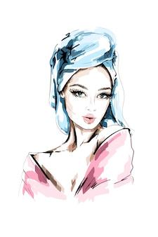 Moda mulher com toalha de banho na cabeça.