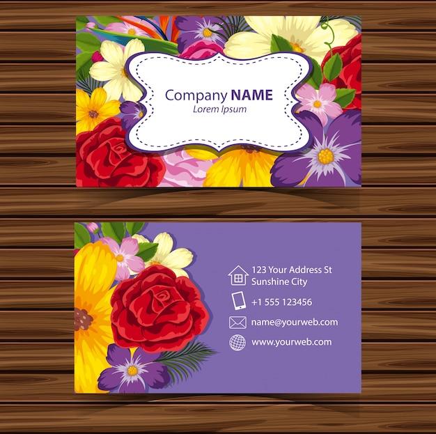 Modelo businesscard com flores no fundo roxo