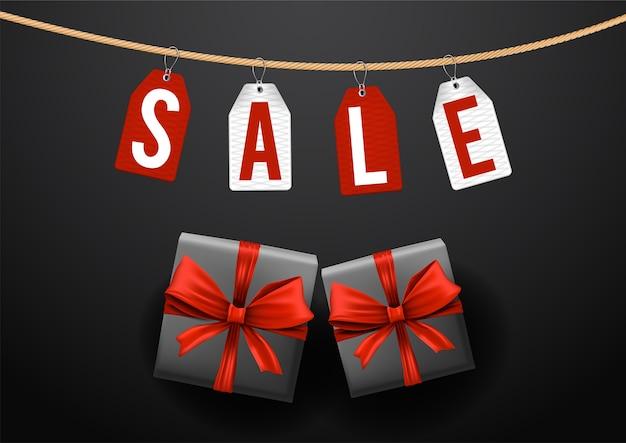 Modelo de banner de caixa preta com fitas vermelhas e etiquetas pretas de venda na sexta-feira