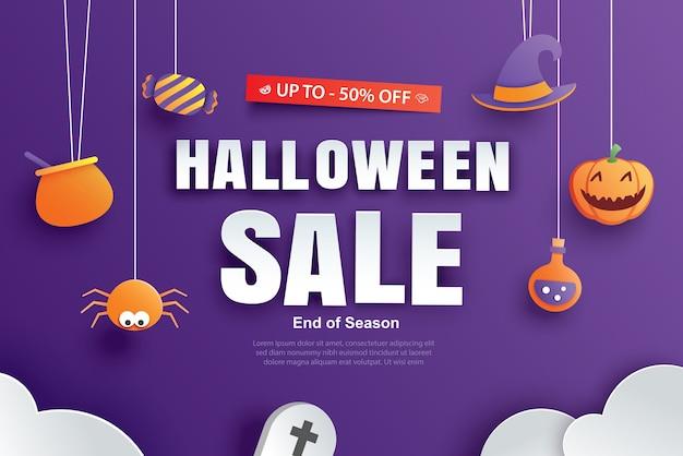 Modelo de banner de promoção de venda de halloween com design de elementos de arte em papel.