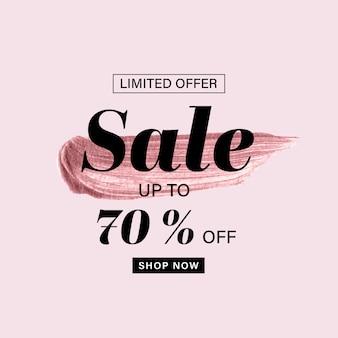 Modelo de banner de venda com pincel rosa ouro pintado e texto de venda no fundo rosa