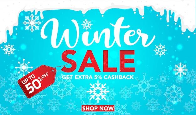 Modelo de banner de venda de inverno com flocos de neve em fundo azul