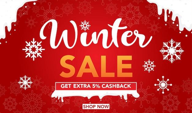 Modelo de banner de venda de inverno com flocos de neve em fundo vermelho