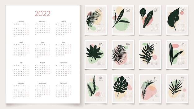 Modelo de calendário 2022 com folhas de palmeira em tons pastel conjunto de 12 meses