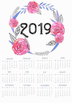 Modelo de calendário de 2019 com coroa de flores em aquarela