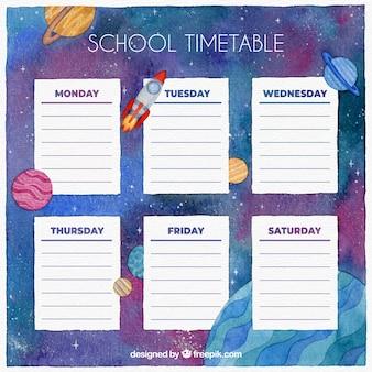 Modelo de calendário escolar com galáxia aquarela