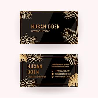 Modelo de cartão com fundo dourado e tropical