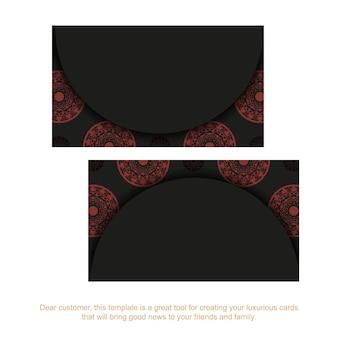 Modelo de cartão com lugar para o seu texto e ornamento vintage. modelo para design de impressão de cartões de visita em preto com padrões de mandala vermelha.