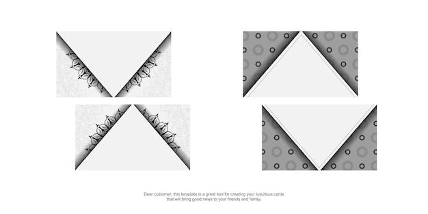 Modelo de cartão com ornamento grego. modelo para impressão de cartões de visita de design cor branca com padrões vintage pretos.