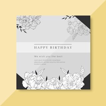 Modelo de cartão de aniversário com enfeites florais