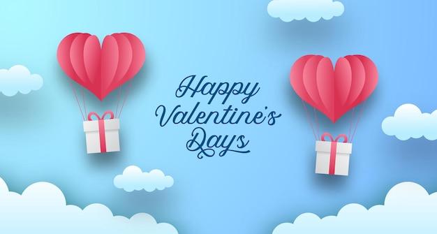 Modelo de cartão de dia dos namorados. balão amor coração com caixa de presente estilo corte de papel com fundo azul céu pastel