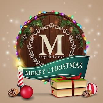 Modelo de cartão de natal com um livro de natal e vela
