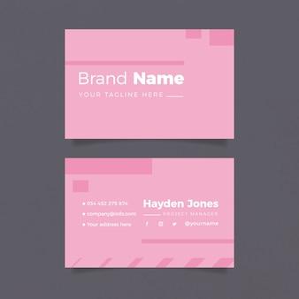 Modelo de cartão de negócios minimalista em tons de rosa
