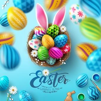 Modelo de cartão de páscoa com ovos de páscoa no ninho e orelhas de coelho sobre fundo azul.