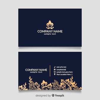 Modelo de cartão de visita com design dourado