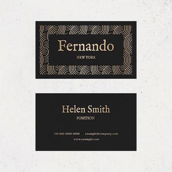 Modelo de cartão de visita de luxo em tons de ouro e preto com flatlay frontal e traseiro