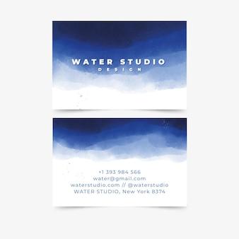Modelo de cartão de visita mergulhado em tinta aquarela Vetor grátis