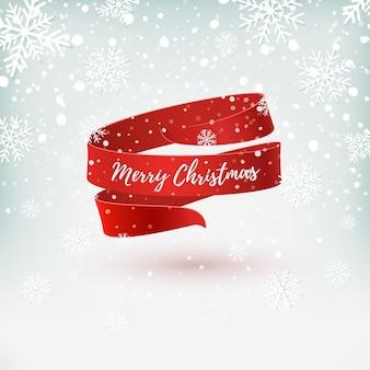 Modelo de cartão, folheto ou cartaz de feliz natal. fita vermelha em fundo de inverno com neve e flocos de neve.