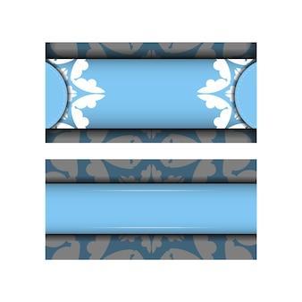 Modelo de cartão postal na cor azul com enfeites brancos vintage para seu projeto.