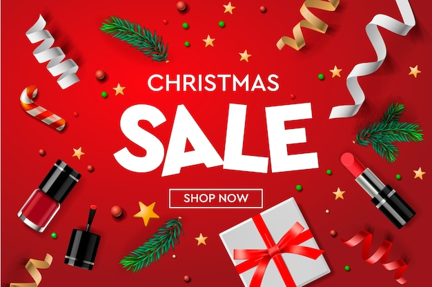 Modelo de cartaz de venda de natal com enfeites de natal, presentes, cosméticos, estrelas, confetes e ramos de abeto. Vetor Premium