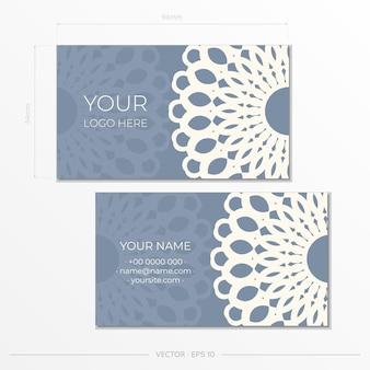 Modelo de design de cartão de visita de cor azul com padrões de luxo. preparação de cartão de visita com ornamentos vintage.