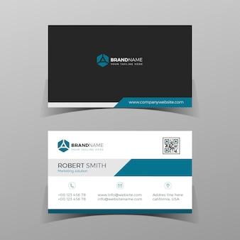 Modelo de design de cartão de visita frente e verso preto e azul no fundo cinza.