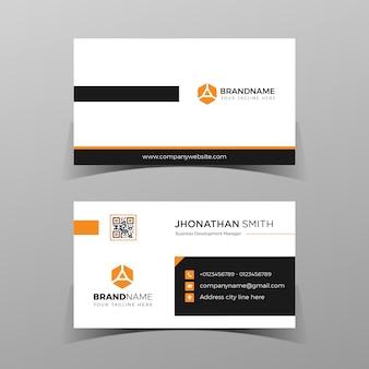 Modelo de design de cartão de visita frente e verso preto e laranja no fundo cinza.
