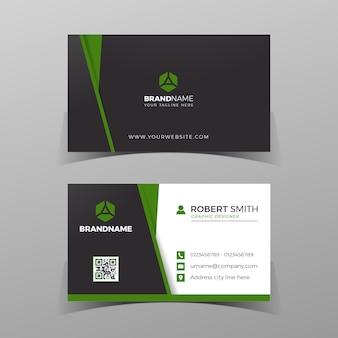 Modelo de design de cartão de visita frente e verso preto e verde no fundo cinza.