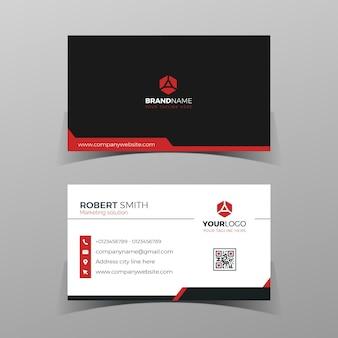 Modelo de design de cartão de visita frente e verso preto e vermelho no fundo cinza.