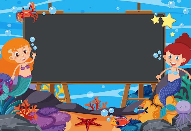 Modelo de design de quadro-negro com sereias e peixes no fundo do oceano