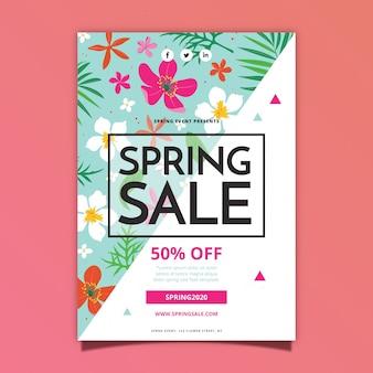 Modelo de design plano de folheto de venda primavera com flores tropicais e folhas