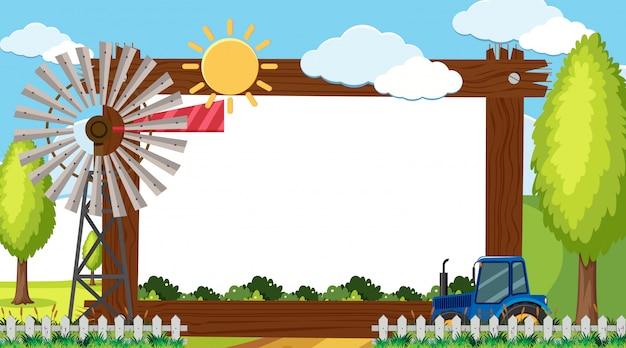 Modelo de fronteira com moinho de vento e trator na fazenda